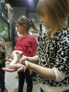 Grace holds a snake